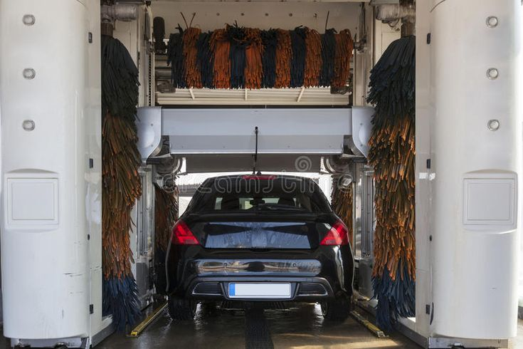 Automatic car wash service car being washed in an