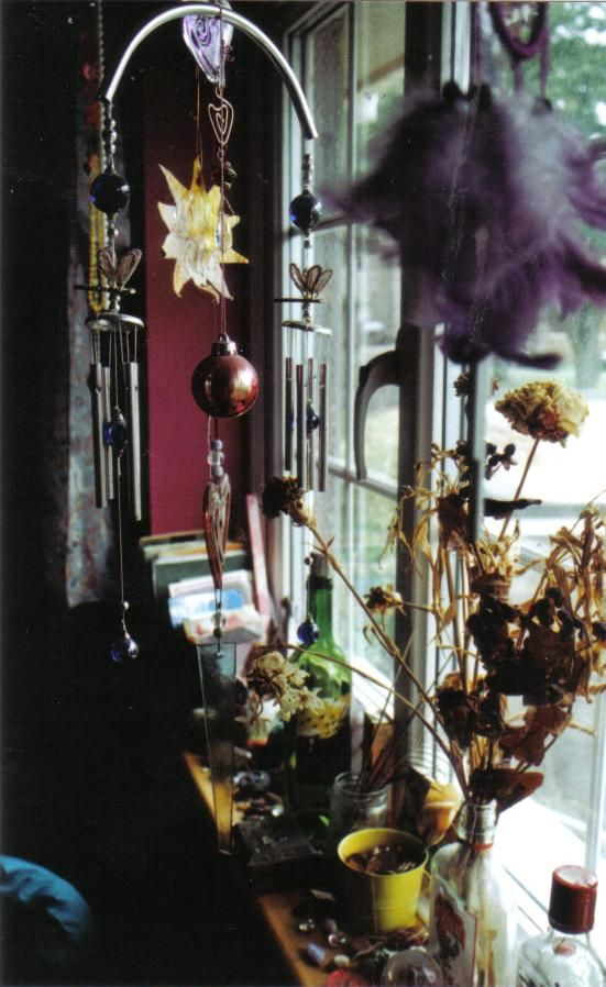 I love this eclectic window display.  I haven't seen a window sill in a house for a long time, though. Maybe a small shelf would work.