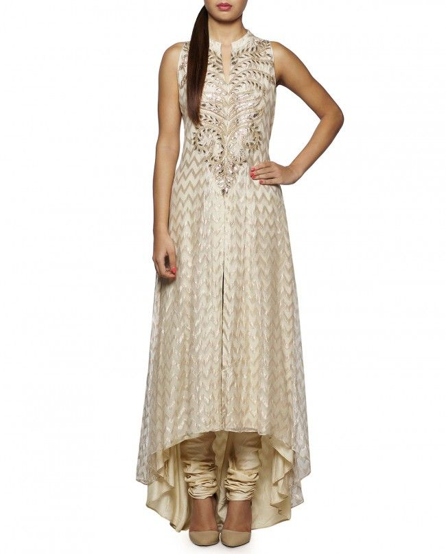 Ivory sleeveless kurta with asymmetric hemline featuring ivory thread woven motifs and gota patti work at yoke. Band collar with hook and eye placket. Wash Care: Dry clean onlyMatching churidar leggings includedClosure: Zip at side