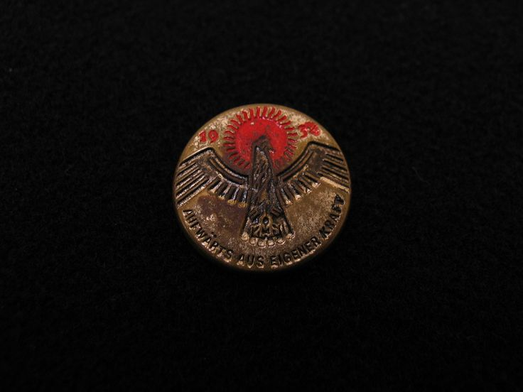 "German political badge, 1934. Inscribed, ""Aufwarts aus Eigener Kraft."" From the collection of the Air Force Museum of New Zealand."