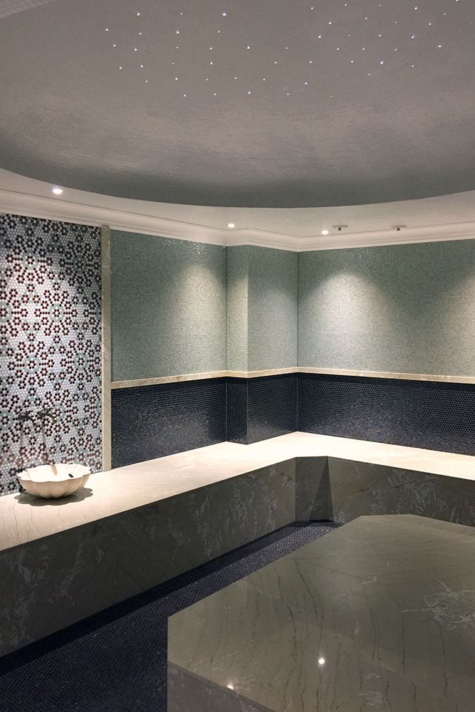 Fiber lighting and spots. Beautiful lights creates a modern look for this spa.