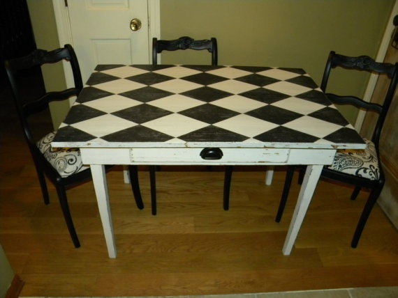 Vintage Black and White Harlequin Desk/ Table via Etsy. Hey, if you find a discarded table, with a bit of painters tape, a can of white paint & a can of black and a bit of elbow grease, you can make your own Harlequin table for your party!