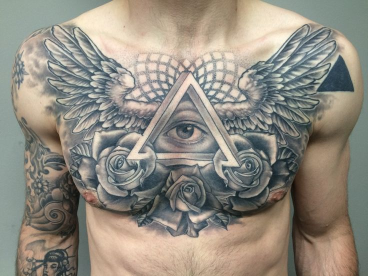 Wings chest piece tattoo