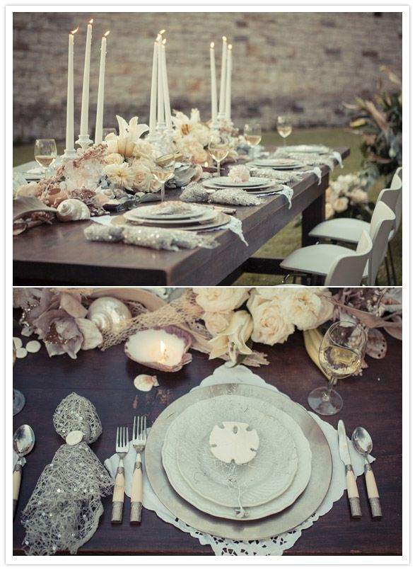 Soft tablescape featuring vintage battenburg lace napkins, sterling silver chargers and bone inlaid flatware with seaside inspired accents.  Styling by Alchemy Fine Events, Photo by Lousie H (http://louiseh.dk/Velkommen.html)