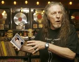 """""""St. James"""" Gurley with a Janis cd of her early folk songs. He died in 2009 of cancer, two days before his 70th birthday."""