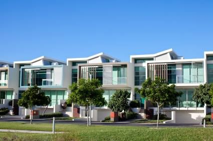Mid range two storey townhouses surrounding a central grassed area. http://www.renovatingperth.com.au/
