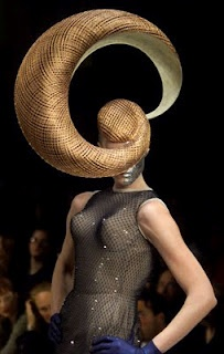 Philip Treacy: The Hat Sculptor not flattering at all but the physics of it!