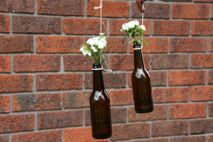 Afternoon Garden Engagement Party hanging beer bottles with flowers