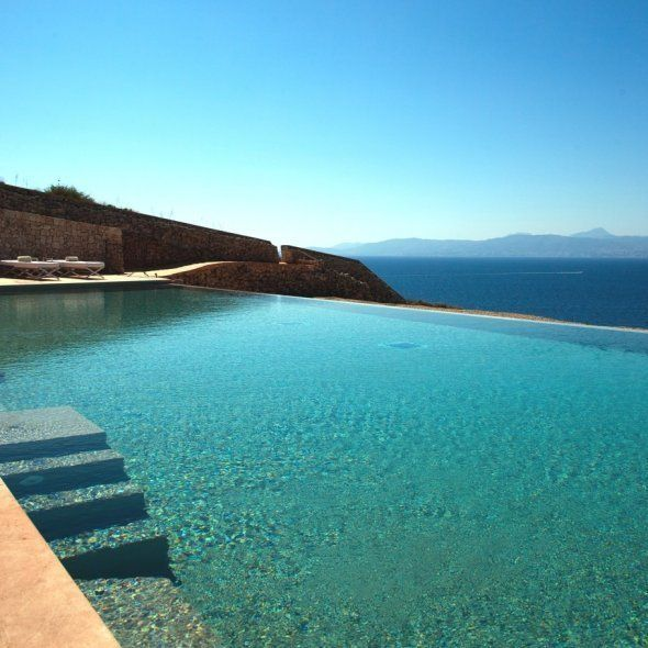 I wanna live in a house with this pool and view...