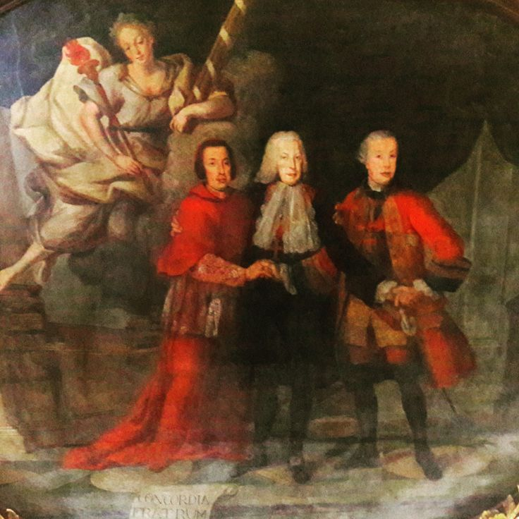 Concordia Fratrum or Brotherly Union. This intriguing and fascinating ceiling fresco depicts the union between three important  brothers in Portugal's history. The Carvalho e Melo brothers, being the one in the middle the most prominent: Sebastião José, also known as Marquis of Pombal. The three represent the union of 3 powers: church, politics and military.