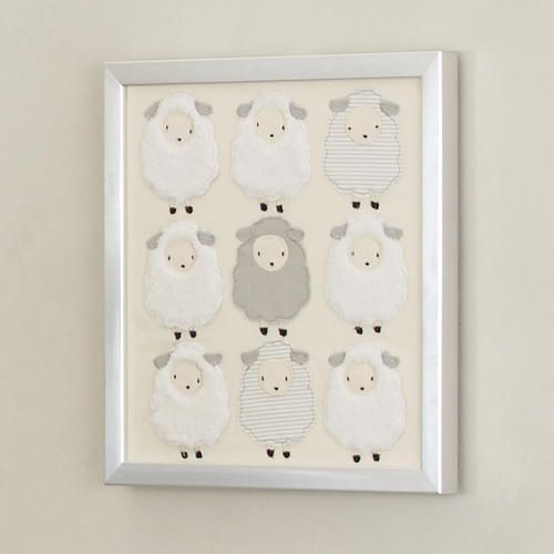 "Our furry little sheep decorate this stunning wall decor complete with a silver metallic frame. Measures 15"" long x 15"" wide. Saw tooth hangers are attached to the back for easy hanging."