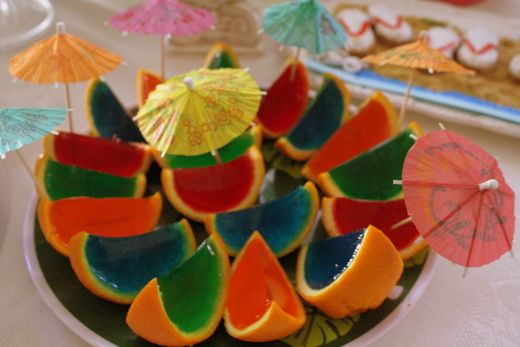 Pour jello shoots into half an orange then once their done, cut them!! Umm...brilliant!
