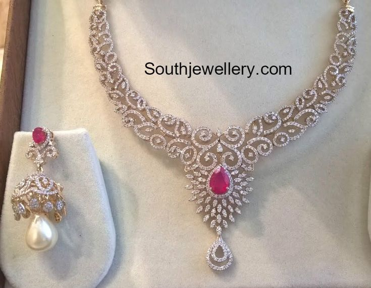 18 carat gold simple diamond necklace and jhumkas set. For inquiries contact: Sri Mahalaxmi Gems and jewellers Secunderabad Phone/WhatsApp no 8125 782 411 Related PostsDiamond Pendant and Jhumkas SetDiamond JhumkasDiamond Choker, Haram and Jhumkas SetSimple Diamond Necklace and JhumkasYami Gautam in a diamond choker setDiamond Necklace and Long Chain Set