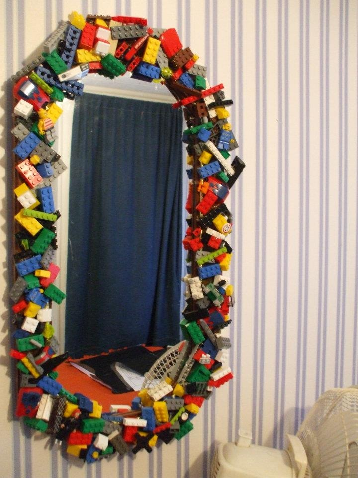 I made this for my stepson when we re-decorated his room. He Loves Lego, so of course I thought he would Love this!!! He does!!!! I took an old mirror and hot glued all the pieces randomly over the frame of the mirror.