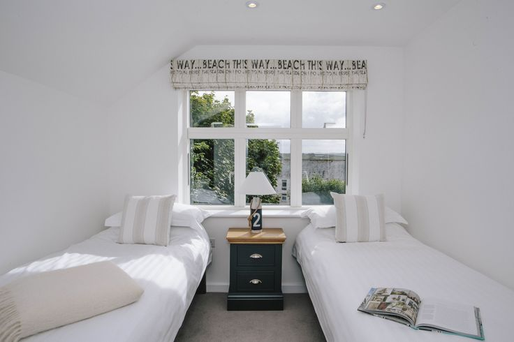 The twin room at 1 The Sands, a self-catering holiday cottage in Polzeath, North Cornwall.