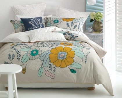 Deco Eleanoa Quilt Cover Set. Add a a burst of colour to your bedroom with this beautifully illustrated floral design. A special gathering technique is a feature in the flower centres and the quilt cover and pillowcases are trimmed with yellow piping. Printed floral reverse.