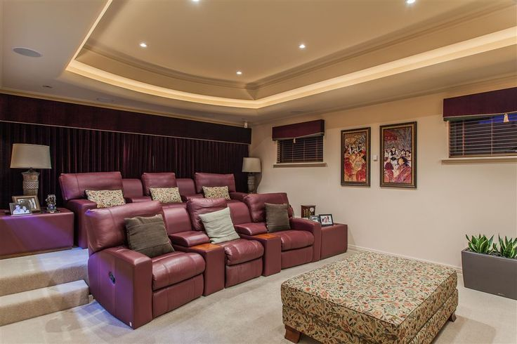 Private theatre room complete with tiered cinema style seatings and dramatic window treatments to complete the atmosphere 22 Conon Road | Perth - Perth Metro | Australia | Luxury Property Selection