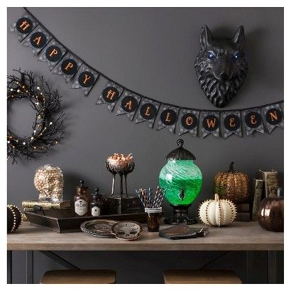 The Eerie Emporium Halloween Party and Decor Collection brings a one-of-a-kind, gothic vibe to your Halloween decor with unique, mix-and-match Halloween decorations such as the hanging spiders chandelier, crow feet candy bowls and studded pumpkins.