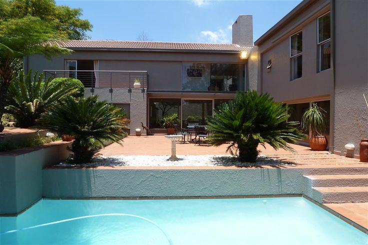 Beautiful tranquil home of distinction. Spacious and light with manicured gardens and sparkling pool. Entertainers delight with a personalised touch. Must see versatile home with well appointed rooms, strong architectural lines and thoughtful planning. #northcliff #johannesburg #pamgolding