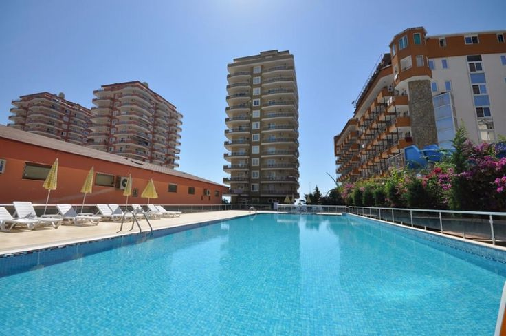 Complex is located in Center of Mahmutlar, near big shoping center Migros, post office, restaurants, cafes, shops and its 12 km from Alanya city center, 25 km to Gazipaşa airport.   2 bedroom apartment is 120 m2 with open plan kitchen, living room, 2 bathroom and 2 Balconies. It is on the 9. floor of 12 storeys building.