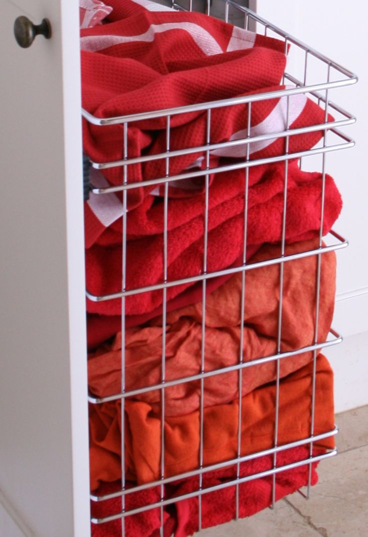 Stainless steel basket which can be attached to doors or cabinets to tidy any room.  Great for the wardrobe.