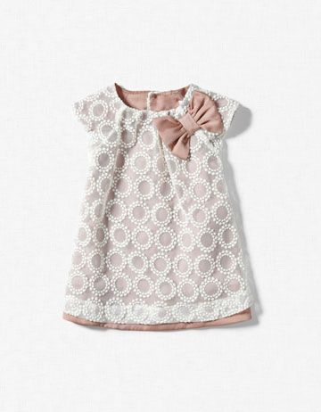 If I had a little girl (that would let me dress her), she'd wear this dress every day.