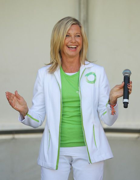 """Olivia Newton-John Photos Photos - Australian actress, Olivia Newton-John performs her song """"Physical"""" on stage before leading the inaugural Wellness Walk on September 15, 2013 in Melbourne, Australia. The event will raise funds for the Olivia Newton-John Cancer and Wellness Centre. - Olivia Newton-John Leads Wellness Walk In Melbourne"""