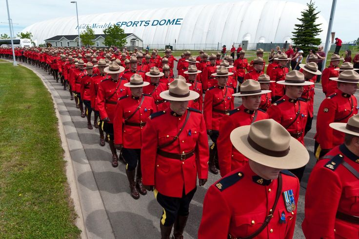 Royal Canadian Mounted Police officers march during a funeral procession for three officers, in Moncton, New Brunswick. The officers, David ...