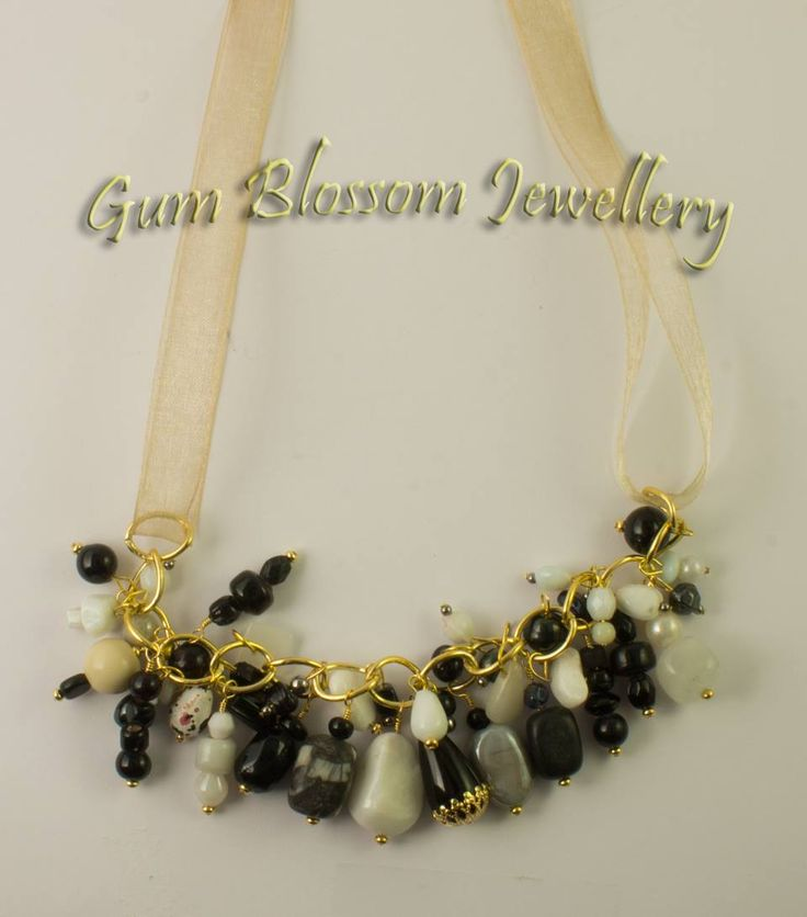 Black and white bead soup on gold coloured chain and gold ribbon will suit many looks