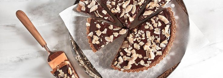 Like a grown-up version of the popular Almond Joy candy bar, this Chocolate-Coconut Tart with Almonds from food writer Ben Mims' balances almonds and sweet chocolate with plenty of salt and toasted coconut. The tart crust needs to be dark brown to ensure that it is cooked through properly and is crunchy. For a chewier, …