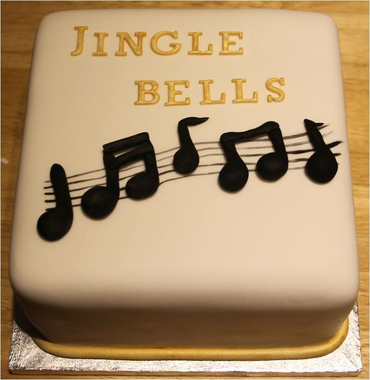 Jingle bells Christmas cake, a simple square design for a covered fruit cake with marzipan and icing.