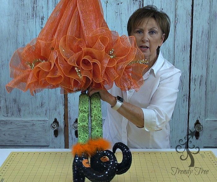 DIY Witch Hat with Legs tutorial by Trendy Tree using Deco Poly Mesh, RAZ Witch Legs and ribbons. Easy to follow directions.