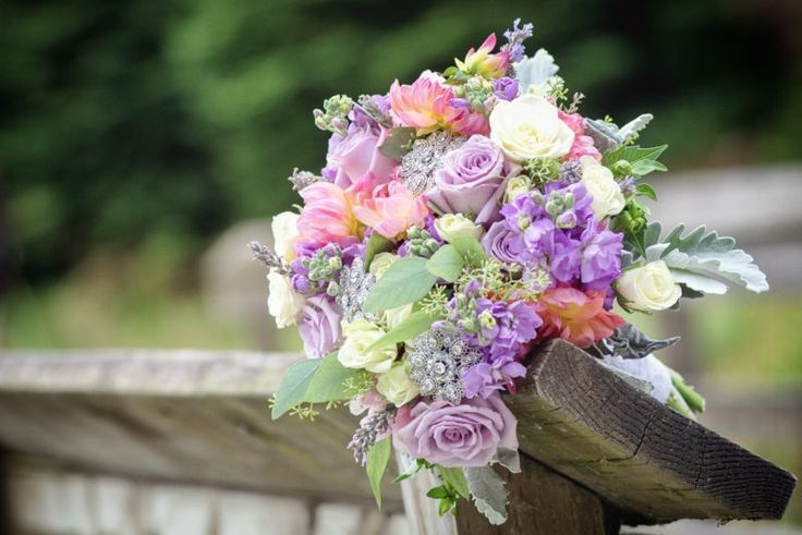 Lavender and peach bouquet, with stock, lavender roses, dahlia, and dusty miller