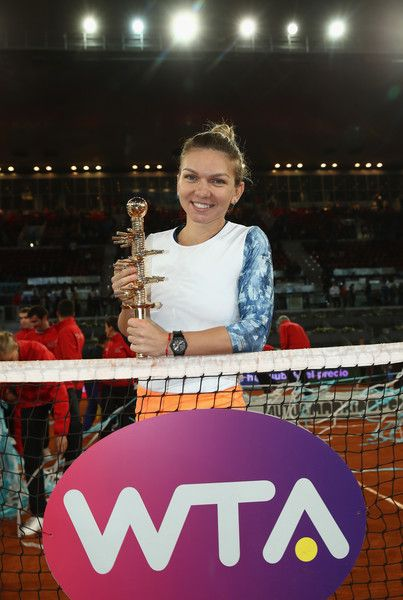 Simona Halep Photos Photos - Simona Halep of Romania with the winners trophy after defeating Kristina Mladenovic of France in the final during day eight of the Mutua Madrid Open tennis at La Caja Magica on May 13, 2017 in Madrid, Spain. - Mutua Madrid Open - Day Eight