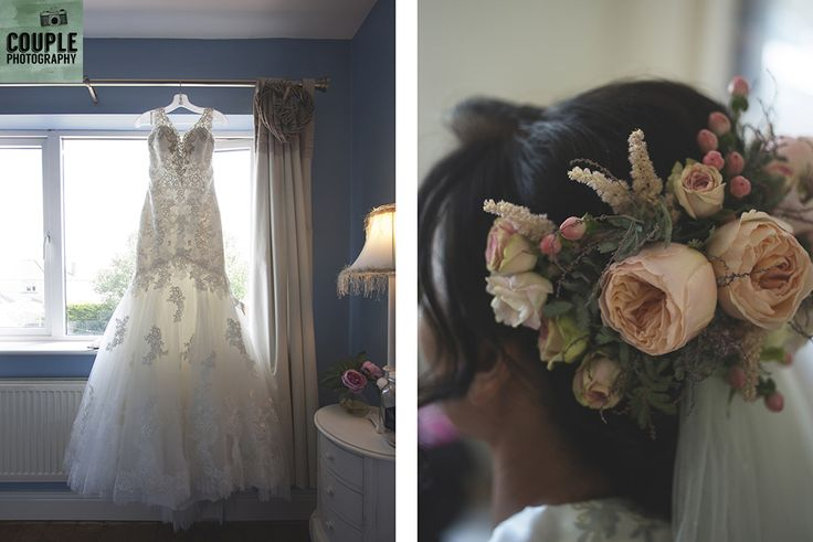 The beautiful wedding dress & the bride's floral hair piece. Weddings at Tankardstown House by Couple  Photography.