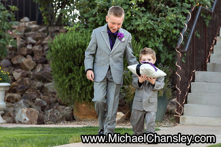 Ring Bearer Walks Down Aisle With Pillow And Brother At Saguaro Buttes Wedding Venue In Tucson
