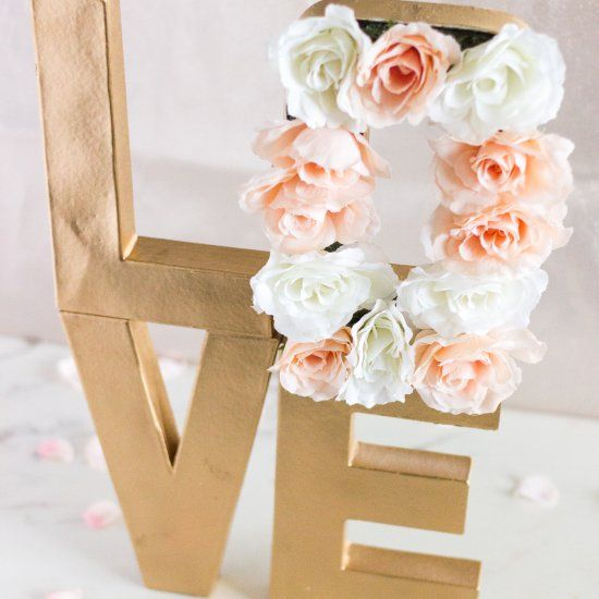 Make this paper mache floral letter centerpiece for your wedding or your next event.
