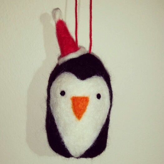Needle felted penguin in a santa hat. Too cute!