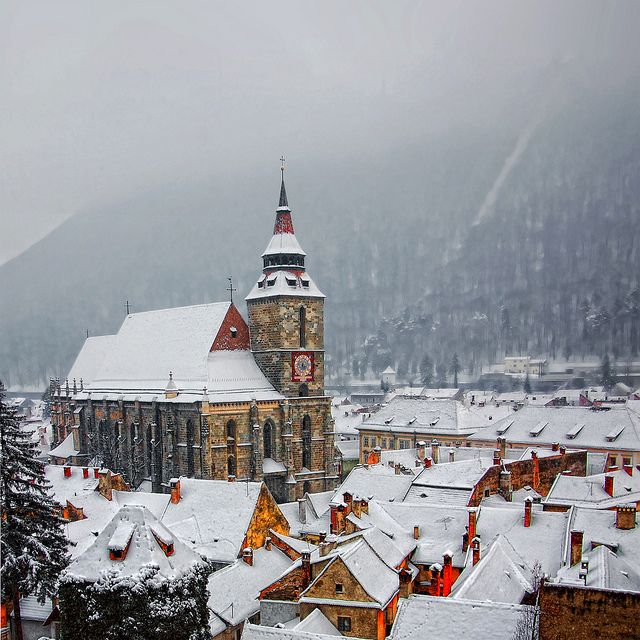 A Winter Tale by 23gxg, via Flickr.  Brasov, Romania in the snow.