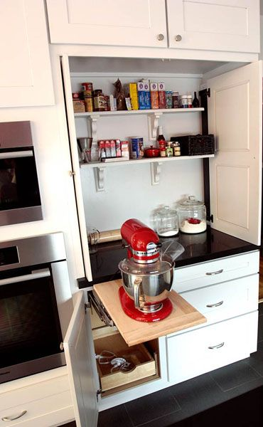 But wait, it does have a cool red mixer ... it's just cleverly hidden from sight when it isn't being used in this custom baking station with retractable doors!
