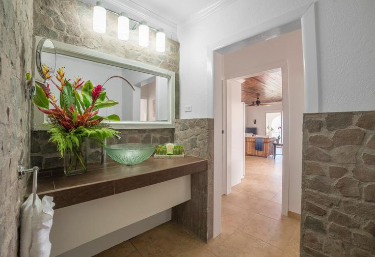 Bathroom: New bathroom sink, fixtures, lights, tiles and a fresh coat of paint! #saba #visitsaba #julianashotel #remodel #renovation #makeover #orchid #orchidcottage