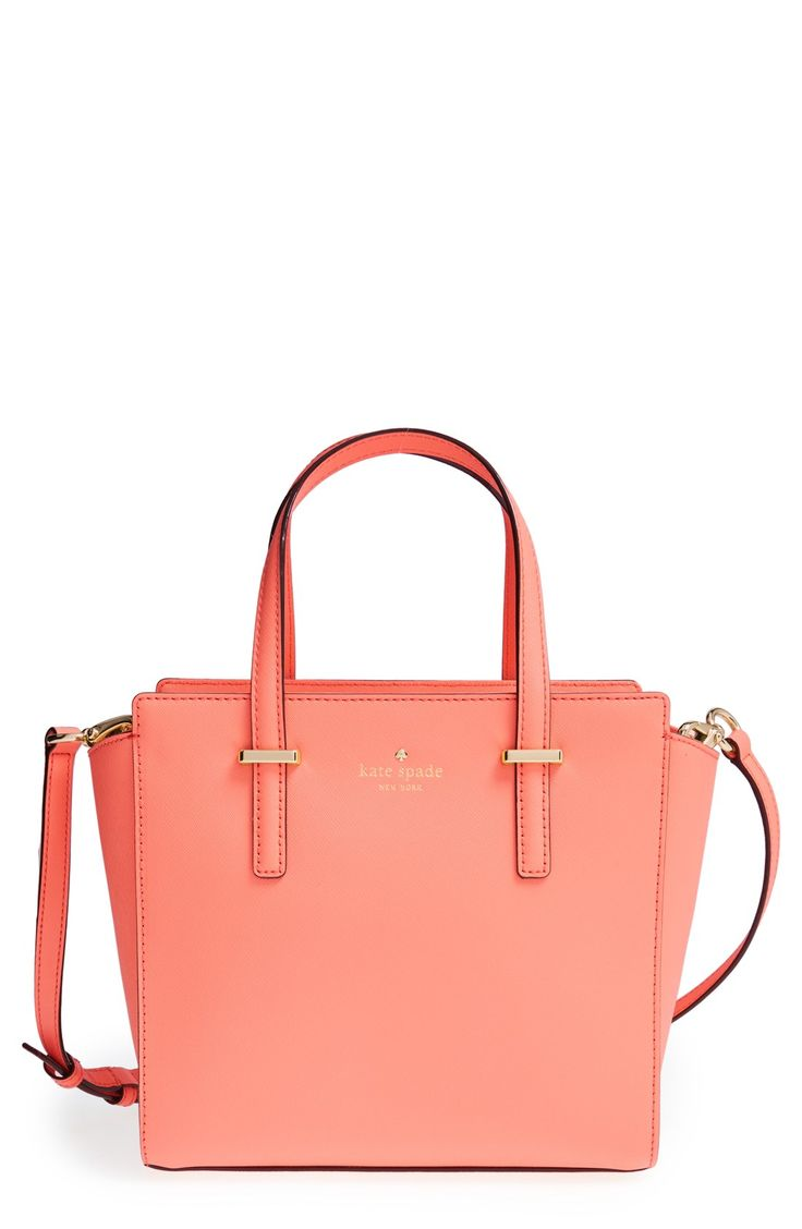 The sleek 14-karat gold-plated hardware adds a polished this sophistication to this pretty coral Kate Spade bag.
