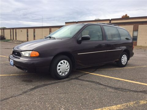 1998 Ford Windstar GL in dark purple with 15'' steel wheels.