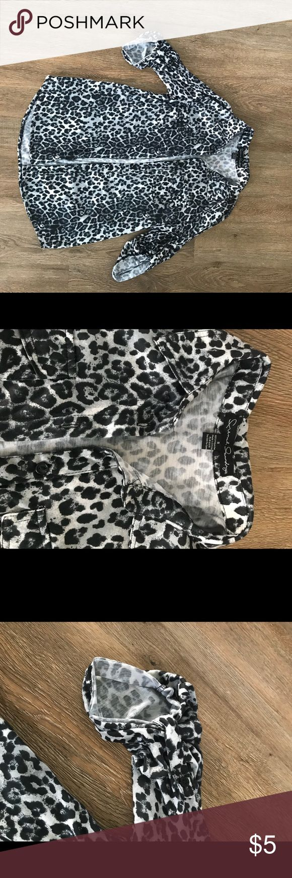 Beautiful Cheetah Print Button down This beautiful cheetah print shirt has been worn once and is in perfect condition! Pairs nicely with black pants or jeans and can be dressed up or down. Sleeves button up to give a classy look. Size: S Tops Button Down Shirts