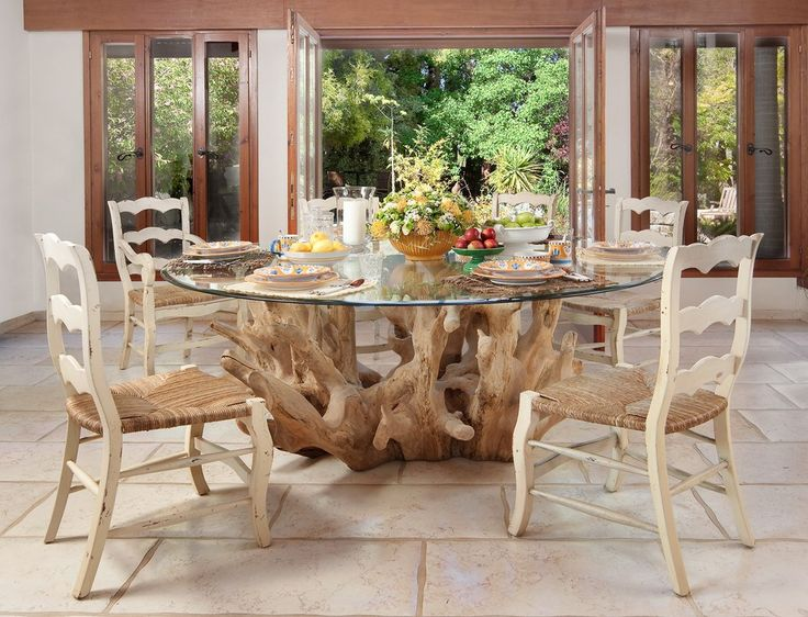 Simple White And Reed Country Chairs Complement This Driftwood And Glass  Table Beautifully.