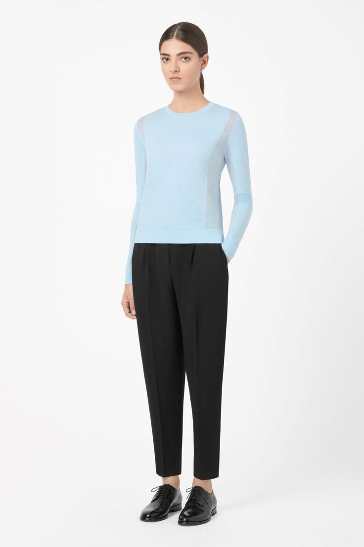 This jumper is made from finely knitted wool with extra-fine panels along the sides and sleeves. A neat fit that is slight cropped, it has long sleeves, a round neckline and soft ribbed edges.
