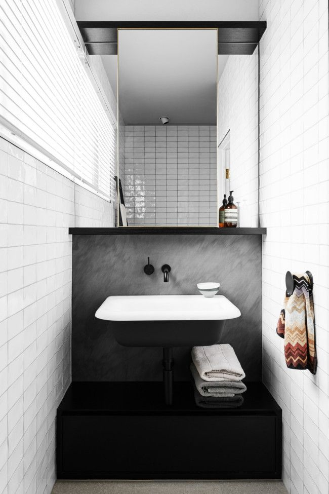 wall mounted agape ottocento washbasin against a backsplash of honed bedonia limestone east melbourne residence by david flack flack studio melbourne
