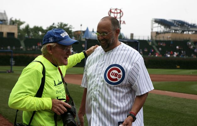 """After throwing the first pitch at last night's Cubs game, Barrington marathon swimmer Doug McConnell is on his way to becoming one of only 15 people over age 50 to achieve the """"Triple Crown of Open Water Swimming"""".  He'll be swimming 28.5 miles around Manhattan Island on Saturday, raising money to help cure the disease that took his father's life...  http://wp.me/p1NGbX-LYN"""
