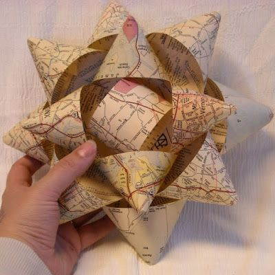 Big Homemade Gift Bows- Easy to make with old maps or scrapbooking paper.