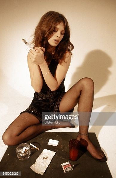 Uschi Obermaier - Model, Author, Germany - smoking a joint